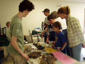 Kids Exploring Bird facts at the Discovery Table
